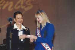 Mrs. Colin Powell presenting MTOA 1997-98 Katy Ballenger with a Best Friend's Friendship Award